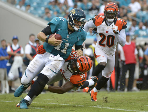 Jacksonville Jaguars quarterback Blaine Gabbert is sacked for a loss by Cincinnati Bengals outside linebacker Vontaze Burfict (55) during the second half of an NFL football game, Sunday, Sept. 30, 2012, in Jacksonville, Fla. Cincinnati beat Jacksonvile 27-10.(AP Photo/Phelan M. Ebenhack)