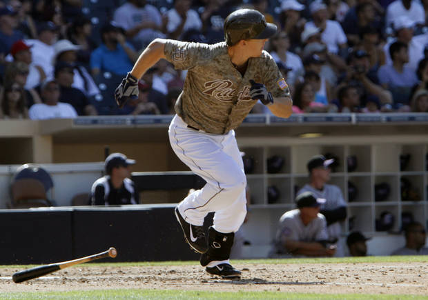 San Diego Padres' Nick Hundley runs after hitting a three-run RBI during the seventh inning against the Colorado Rockies during the baseball game on Sunday, Sept. 8, 2013, in San Diego. (AP Photo/Don Boomer)