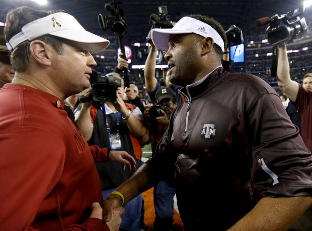 Oklahoma coach Bob Stoops meets with Texas A&M coach Kevin Sumlin after the Cotton Bowl college football game between the University of Oklahoma (OU)and Texas A&M University at Cowboys Stadium in Arlington, Texas, Friday, Jan. 4, 2013. Oklahoma lost 41-13. Photo by Bryan Terry, The Oklahoman