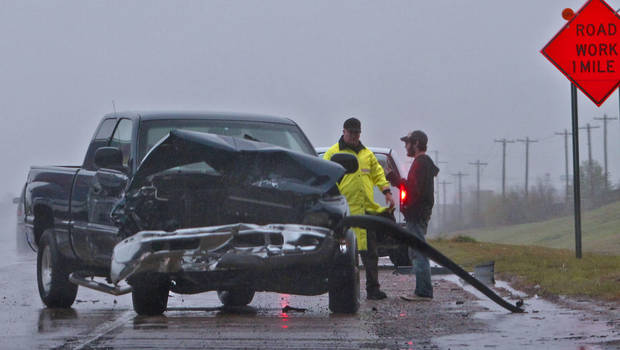 An Oklahoma Highway Patrolman works the scene of an accident on I-40 on Monday, March 19, 2012, in Oklahoma City, Oklahoma.  Photo by Chris Landsberger, The Oklahoman