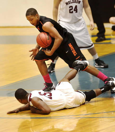 Douglass&#039; Dior Smiley ends up with the basketball after Muldrow&#039;s Dominic Blue lost control of it while trying to pass to a teammate, forcing Blue to fall backward onto the floor during first round games of Class 4A basketball state tournament in the Lyle Boren Activity Center at Choctaw High School on Thursday,  March 7, 2013.  Photo by Jim Beckel, The Oklahoman