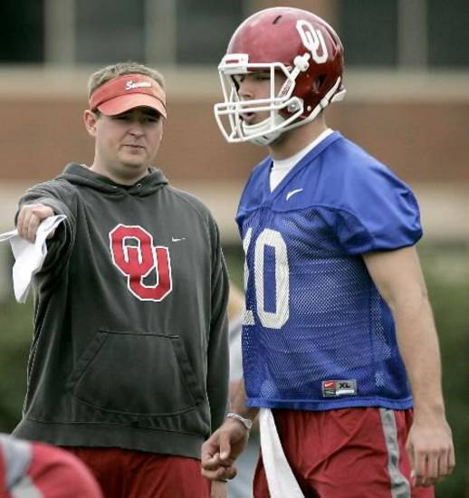 Josh Heupel talks with Blake Bell during the first day of spring practice at the University of Oklahoma in Norman on Monday, March 21, 2011. (Photo by John Clanton, The Oklahoman)