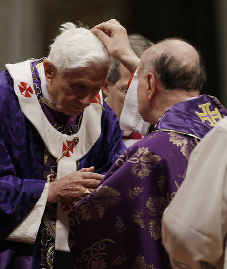 "Cardinal  Angelo Comastri puts ash on Pope Benedict XVI's head during the celebration of Ash Wednesday mass in St. Peter's Basilica at the Vatican, Wednesday, Feb. 13, 2013.  Ash Wednesday marks the beginning of Lent, a solemn period of 40 days of prayer and self-denial leading up to Easter. Pope Benedict XVI told thousands of faithful Wednesday that he was resigning for ""the good of the church"", an extraordinary scene of a pope explaining himself to his flock that unfolded in his first appearance since dropping the bombshell announcement. (AP Photo/Gregorio Borgia)"