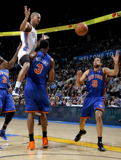 Oklahoma City's Eric Maynor loses control of the ball as he hits New York's Shawne Williams while Landry Fields watches during the NBA basketball game between the Oklahoma City Thunder and the New York Knicks at the Oklahoma City Arena in Oklahoma City on Saturday, January 22, 2011.  Photo by Bryan Terry, The Oklahoman
