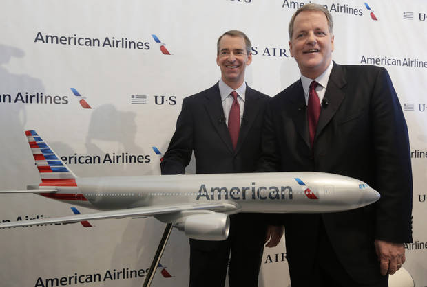 U.S. Airways CEO Doug Parker, right, and American Airlines CEO Tom Horton pose after a news conference at DFW International Airport Thursday, Feb. 14, 2013, in Grapevine, Texas. The two airlines will merge forming the world's largest airlines.  (AP Photo/LM Otero)
