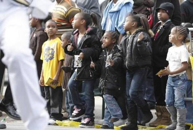 Children watch as a marching band passes during the Dr. Martin Luther King Jr.  Parade in Little Rock, Ark. Monday Jan. 18, 2010. (AP Photo/Brian Chilson)