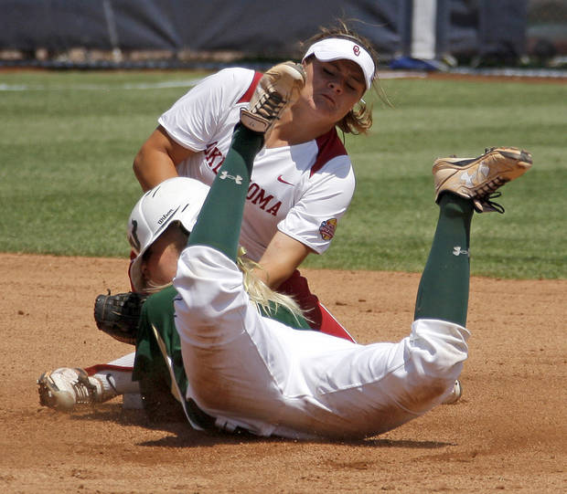 Oklahoma's Georgia Casey tags out South Florida's Jessica Mouse in the first inning of a Women's College World Series game at ASA Hall of Fame Stadium in Oklahoma City, Thursday, May 31, 2012.  Photo by Bryan Terry, The Oklahoman