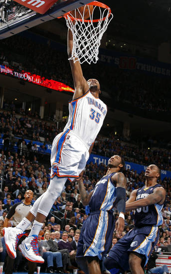 Oklahoma City's Kevin Durant (35) dunks over Memphis' Chris Johnson (4)  and Darrell Arthur (00) during the NBA basketball game between the Oklahoma City Thunder and the Memphis Grizzlies at the Chesapeake Energy Arena in Oklahoma City,  Thursday, Jan. 31, 2013.Photo by Sarah Phipps, The Oklahoman
