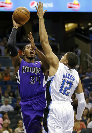 Sacramento Kings' Jason Thompson (34) shoots over Orlando Magic's Tobias Harris (12) during the first half of an NBA basketball game, Wednesday, Feb. 27, 2013, in Orlando, Fla. (AP Photo/John Raoux)