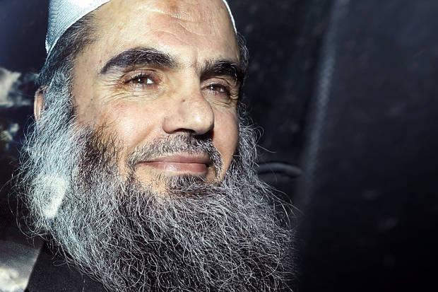 FILE - This is a  Tuesday, April 17, 2012 file photo,  of radical Islamist cleric  Abu Qatada as he  is driven away after being refused bail at a hearing at London's Special Immigration Appeals Commission, which handles deportation and security cases, in London. The British government on Monday Dec. 3, 2012 is challenging a court ruling that it cannot deport to Jordan the radical Islamist cleric Abu Qatada, who has been described by prosecutors as a key al-Qaida operative in Europe. (AP Photo/Matt Dunham, File)