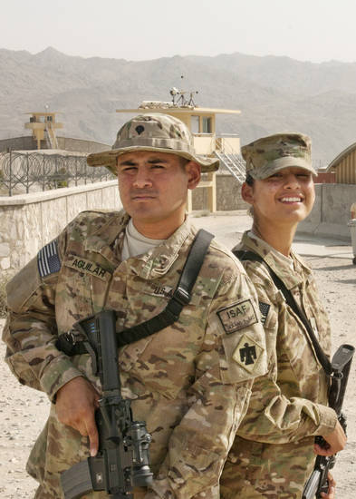 MILITARY / SPC. JOEL AGUILAR: Spc. Joel and Pvt. Raquel Aguilar of Oklahoma City, Okla., with Headquarters, Headquarters Company, 45th Infantry Brigade Combat Team poses for a picture together July 16, at Forward Operating Base Gamberi, Afghanistan. Both Joel And Raquel are on their first deployment.(Photo by Spc. Leslie Goble, Task Force Thunderbird Public Affairs Office)