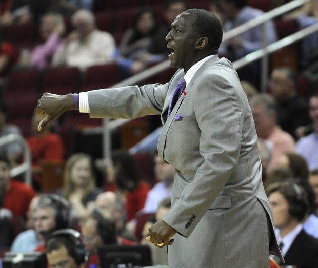 Utah Jazz coach Tyron Corbin yells to his players in the first half of an NBA basketball game against the Houston Rockets, Saturday, Dec. 1, 2012, in Houston. (AP Photo/Pat Sullivan)