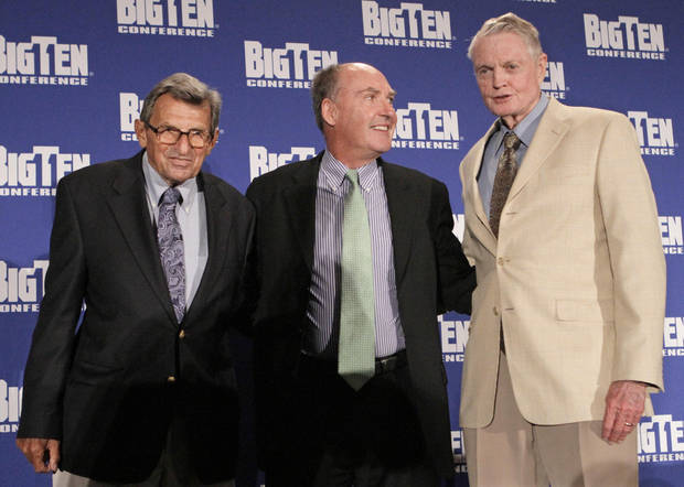 Penn State head football coach Joe Paterno, left, and Nebraska athletic director Tom Osborne, right, join Big Ten Commiissioner Jim Delany on stage, Monday, Aug. 2, 2010, in Chicago, at the 2010 Big 10 Media Day Kickoff. Nebraska, became the newest member of the Big ten since Penn State joined the conference 20 years ago. (AP Photo/M. Spencer Green) ORG XMIT: CX109