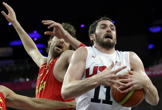 United States' Kevin Love grabs a rebound in front of Spain's Pau Gasol during a men's gold medal basketball game at the 2012 Summer Olympics, Sunday, Aug. 12, 2012, in London. (AP Photo/Eric Gay)