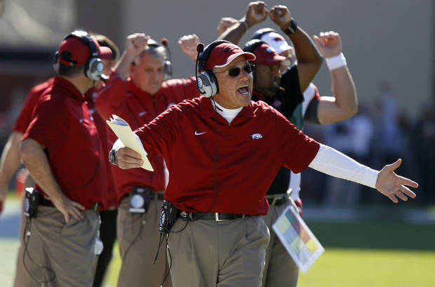 Arkansas interim head coach John L. Smith shouts toward officials in the second quarter of their NCAA college football game against Mississippi State in Starkville, Miss., Saturday, Nov. 17, 2012. Mississippi State won 45-14. (AP Photo/Rogelio V. Solis)