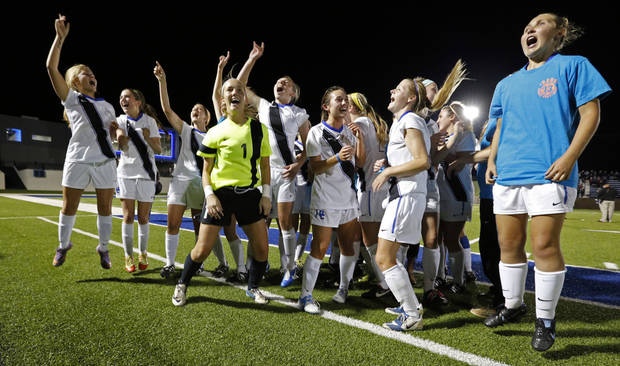 Deer Creek players celebrate their championship in the Class 5A girls state soccer championship game between Deer Creek and Carl Albert on Friday, May 10, 2013 in Noble, Okla.  Photo by Steve Sisney, The Oklahoman
