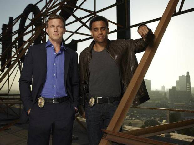COMMON LAW -- Season:1 -- Pictured: (l-r) Warren Kole as Wes, Michael Ealy as Travis -- Photo by: Robert Ascroft/USA Network