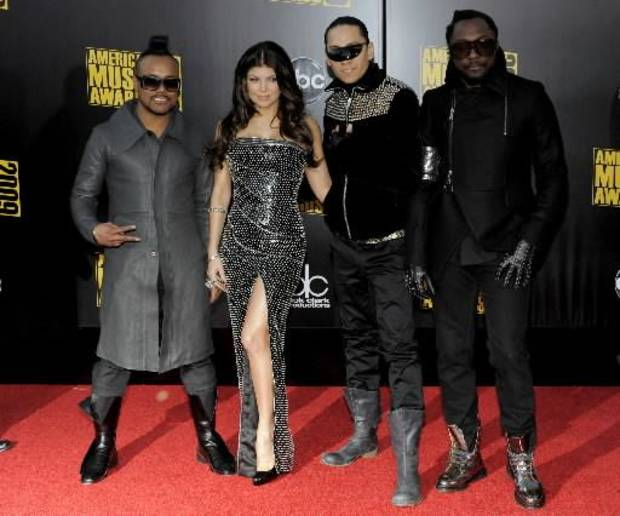 The Black Eyed Peas on the red carpet at the American Music Awards. (AP Photo/Chris Pizzello)