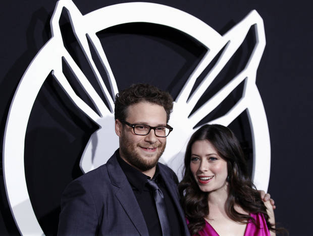 "Cast member Seth Rogen, left, and Lauren Miller arrive at the premiere ""The Green Hornet"" in Los Angeles, on Monday, Jan 10, 2011.  (AP Photo/Matt Sayles)"
