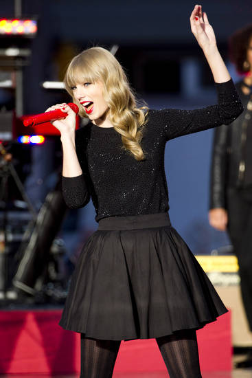 "FILE - In this Tues., Oct. 23, 2012 file photo, Taylor Swift performs on ABC's ""Good Morning America,"" in New York. Brad Paisley and Carrie Underwood co-host the CMA awards show on Thursday, Nov. 1, 2012, at 8 p.m. EDT, live on ABC from the Bridgestone Arena in Nashville. From Taylor Swift's army of empowered young women to the power-drinking party boys who prefer Church and Jason Aldean, country's audience is much different than it was 10 years ago and that's reflected in the awards. (Photo by Charles Sykes/Invision/AP, File) ORG XMIT: CAENT473"