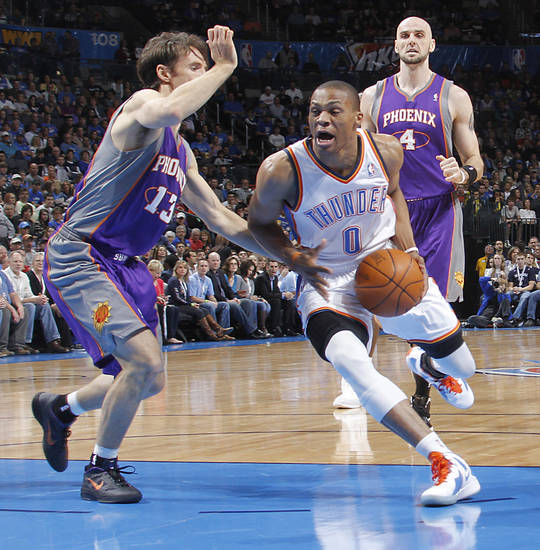 Oklahoma City Thunder point guard Russell Westbrook (0) drives past Phoenix Suns point guard Steve Nash (13) during the NBA basketball game between the Oklahoma City Thunder and the Phoenix Suns at the Chesapeake Energy Arena on Wednesday, March 7, 2012 in Oklahoma City, Okla.  Photo by Chris Landsberger, The Oklahoman