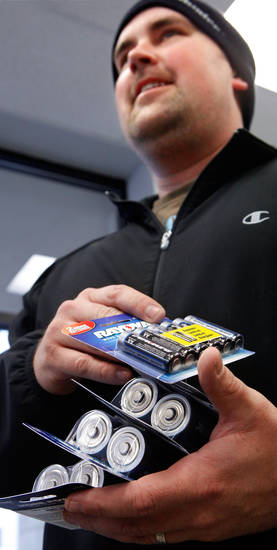 Jason Austin waits in line at BatteriesPlus to purchase batteries for flashlights Thursday,  Jan. 28, 2010. Many customers came into the store looking for lanterns, flashlights and 'D' cell batterries. Photo by Jim Beckel, The Oklahoman