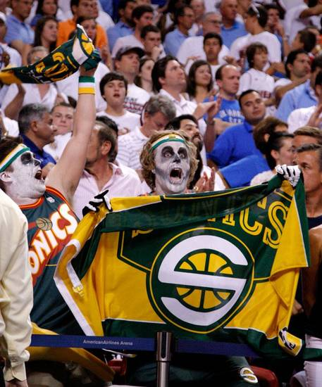 Seattle Sonics fans cheer behind the Thunder bench during Game 4 of the NBA Finals between the Oklahoma City Thunder and the Miami Heat at American Airlines Arena, Tuesday, June 19, 2012. Oklahoma City lost 104-98.  Photo by Bryan Terry, The Oklahoman