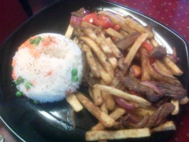 Lomo Saltado with steamed rice. Or as I like to call it, Steak Fries.