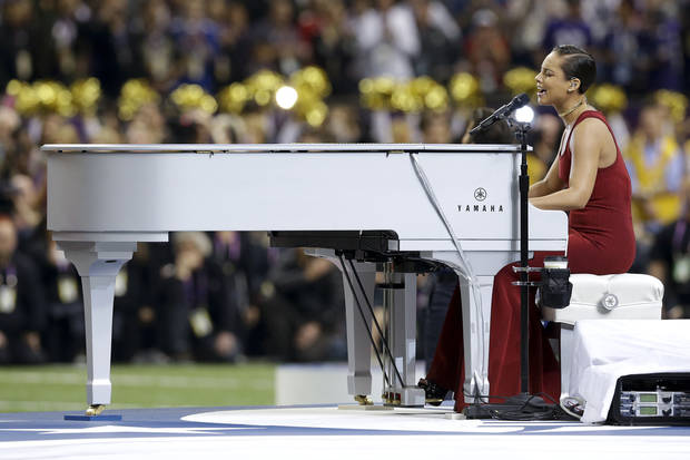Alicia Keys sings the national anthem before the NFL Super Bowl XLVII football game between the San Francisco 49ers and the Baltimore Ravens, Sunday, Feb. 3, 2013, in New Orleans. (AP Photo/Patrick Semansky)