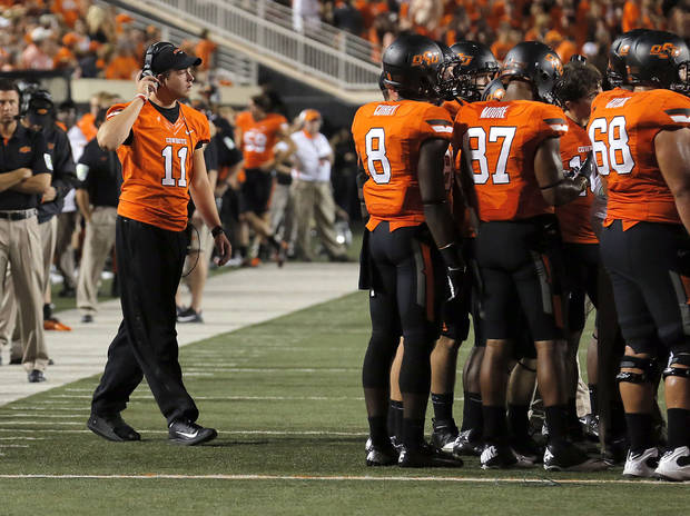 Oklahoma State&#039;s Wes Lunt (11) walks to the OSU huddle during a college football game between Oklahoma State University (OSU) and the University of Texas (UT) at Boone Pickens Stadium in Stillwater, Okla., Saturday, Sept. 29, 2012. Photo by Sarah Phipps, The Oklahoman