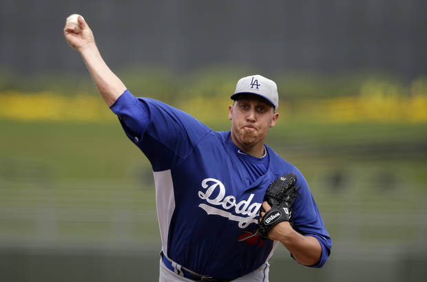 Los Angeles Dodgers starting pitcher Aaron Harang throws against the Kansas City Royals during the second inning in an exhibition spring training baseball game Wednesday, March 20, 2013, in Surprise, Ariz. (AP Photo/Gregory Bull)