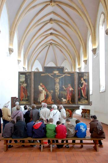 Visitors contemplate Matthias Grunewald's masterpiece, the Isenheim Altarpiece. (Photo by Cameron Hewitt)