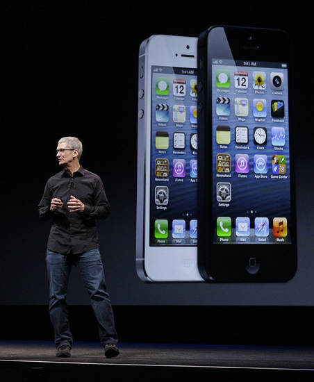Apple CEO Tim Cook talks on stage Wednesday during the introduction of the new iPhone 5 in San Francisco. AP Photo