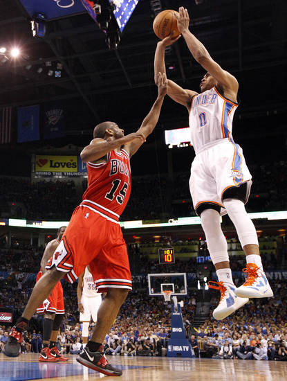 Oklahoma City's Russell Westbrook (0) shoots over Chicago's John Lucas (15) during the NBA basketball game between the Chicago Bulls and the Oklahoma City Thunder at Chesapeake Energy Arena in Oklahoma City, Sunday, April 1, 2012. Photo by Sarah Phipps, The Oklahoman