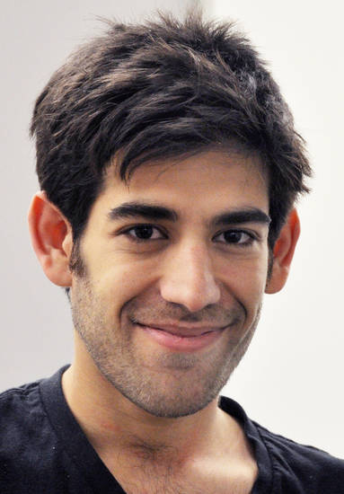 This Dec. 8, 2012 photo provided by ThoughtWorks shows Aaron Swartz, in New York. Swartz, a co-founder of Reddit, hanged himself Friday, Jan. 11, 2013, in New York City. Since his suicide, friends and admirers have eulogized the 26-year-old free-information activist as a martyred hero, hounded to his death by the government he antagonized. (AP Photo/ThoughtWorks, Pernille Ironside)