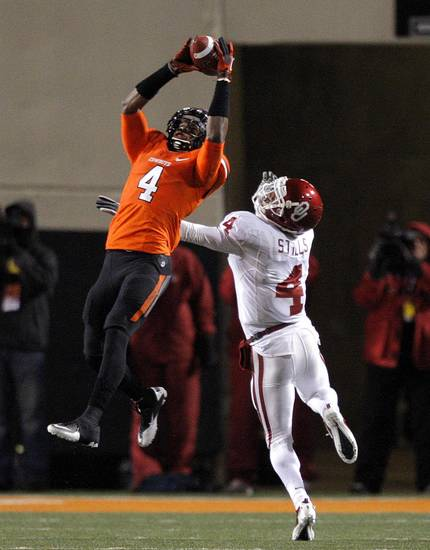 Oklahoma State's Justin Gilbert (4) makes an interception in front of Oklahoma's Kenny Stills (4) during the Bedlam college football game between the Oklahoma State University Cowboys (OSU) and the University of Oklahoma Sooners (OU) at Boone Pickens Stadium in Stillwater, Okla., Saturday, Dec. 3, 2011. Photo by Sarah Phipps, The Oklahoman