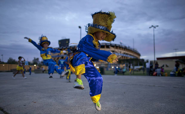 "Members of the murga ""Los amantes de La Boca"" rehearse before participating in carnival celebrations in Buenos Aires, Argentina, Saturday, Feb. 2, 2013. Argentina�s carnival celebrations may not be as well-known as the ones in neighboring Uruguay and Brazil, but residents of the nation�s capital are equally passionate about their �murgas,� or traditional musical troupes. The murga ""Los amantes de La Boca,� or �The Lovers of The Boca� is among the largest, with about 400 members. It�s a reference to the hometown Boca Juniors, among the most popular soccer teams in Argentina and the world. (AP Photo/Natacha Pisarenko)"