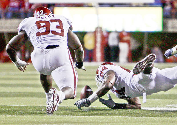 OU's Gerald McCoy, left, and Frank Alexander go after a Nebraska fumble in the first half Saturday in Lincoln, Neb. Photo by Sarah Phipps, The Oklahoman