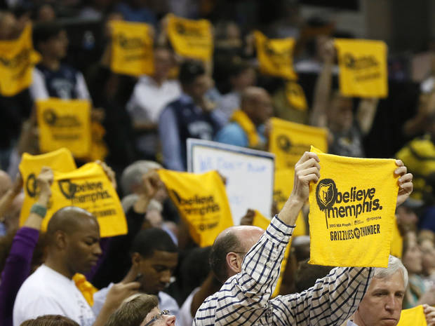 Memphis fans hold up Growl Towels during Game 3 in the second round of the NBA basketball playoffs between the Oklahoma City Thunder and Memphis Grizzles at the FedExForum in Memphis, Tenn.,  Saturday, May 11, 2013. Memphis won, 87-81. Photo by Nate Billings, The Oklahoman
