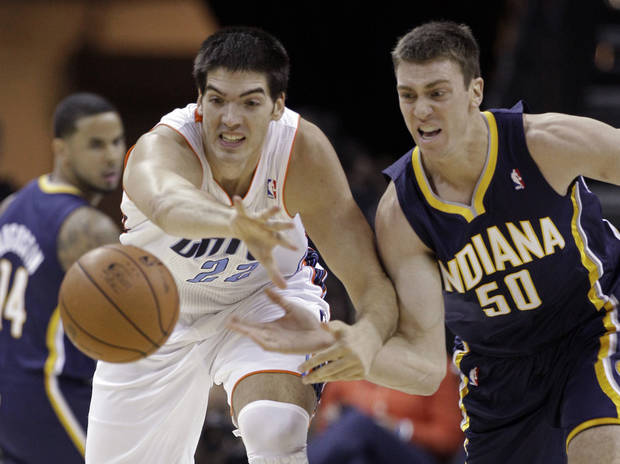 Indiana Pacers' Tyler Hansbrough (50) and Charlotte Bobcats' Byron Mullens (22) chase a loose ball during the first half of an NBA basketball game in Charlotte, N.C., Friday, Nov. 2, 2012. (AP Photo/Chuck Burton)