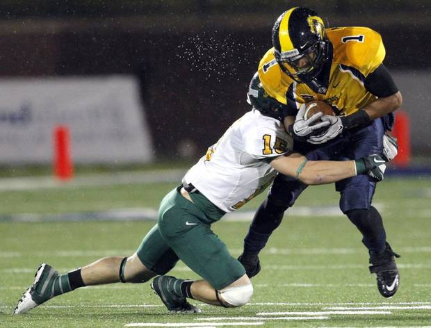 UCO's Terrance Davis (1) is tackled by Black Hills' Joey Brown during the college game between the University of Central Oklahoma and Black Hills State at Wantland Stadium in Edmond, Okla., Thursday, Oct. 27, 2011. Photo by Sarah Phipps, The Oklahoman