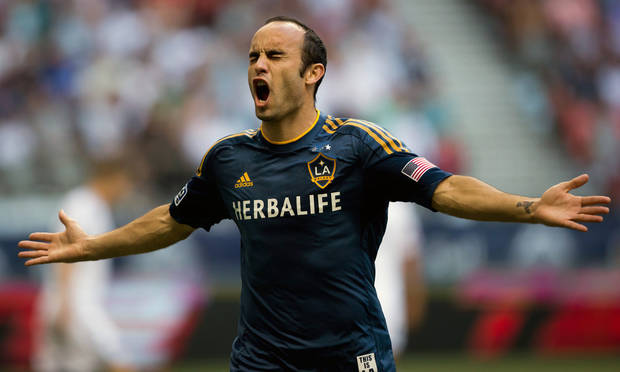 Los Angeles Galaxy's Landon Donovan celebrates after scoring a goal against the Vancouver Whitecaps during the first half of an MLS soccer game in Vancouver, British Columbia, Saturday, Aug. 24, 2013. (AP Photo/The Canadian Press, Darryl Dyck)