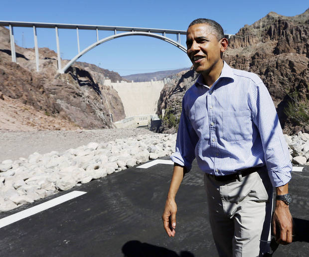   President Barack Obama stands at the heliport overlooking the Hoover Dam, Tuesday, Oct. 2, 2012 in Boulder City, Nev. (AP Photo/Pablo Martinez Monsivais)  