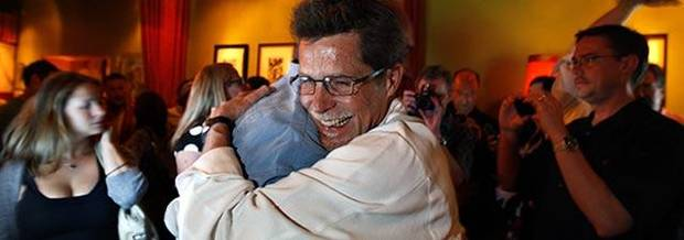 Rick Bayless embraces Art Smith, a fellow Top Chef Masters competitor, after Wednesday's finale.