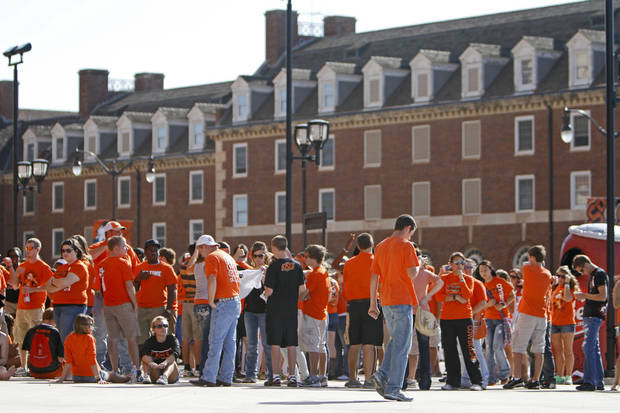Fans line up outside Boone Pickens Stadium before before the OSU-Arizona game Thursday in Stillwater. PHOTO BY BRYAN TERRY, The Oklahoman