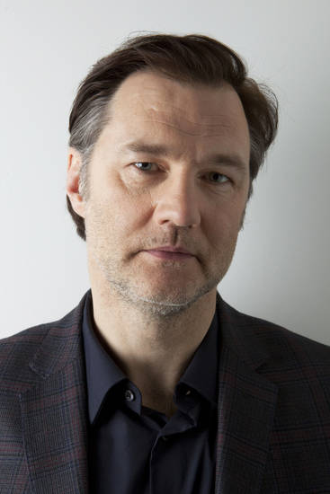 "This Jan. 28, 2013 photo shows actor David Morrissey from AMC Network's ""The Walking Dead"", poses for a portrait in New York.  The popular zombie series returns for another eight episodes Sunday at 9 p.m. EST. (Photo by Amy Sussman/Invision/AP)"