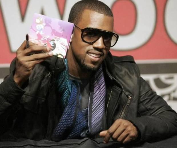 Kanye West signing autographs in Los Angeles in 2007. (AP Photo/Dan Steinberg)