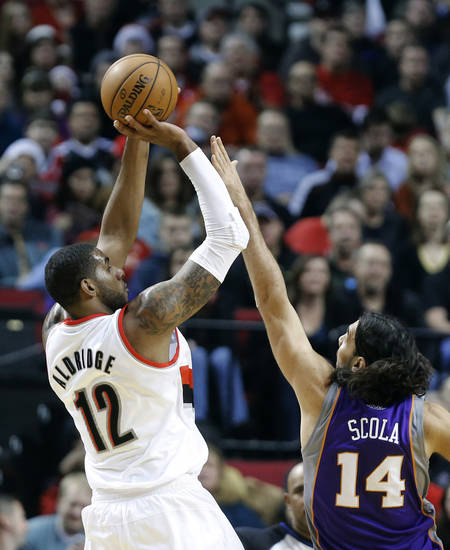 Portland Trail Blazers forward LaMarcus Aldridge, left, shoots over Phoenix Suns forward Luis Scola, from Argentina, during the first quarter of an NBA basketball game in Portland, Ore., Saturday, Dec. 22, 2012. (AP Photo/Don Ryan)