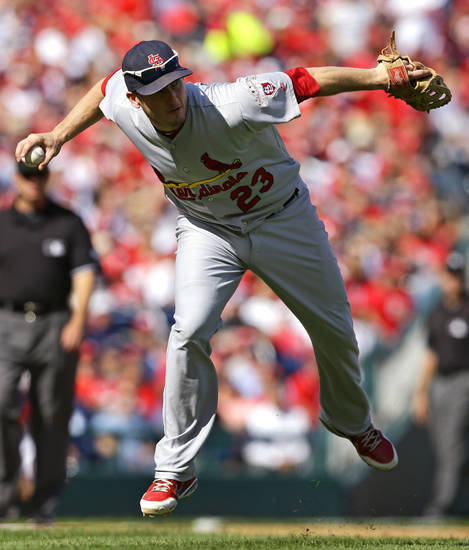 St. Louis Cardinals third baseman David Freese fields a ground ball that was hit by Washington Nationals' Danny Espinosa in the second inning of Game 3 of the National League division baseball series on Wednesday, Oct. 10, 2012, in Washington. Espinosa was thrown out at first. (AP Photo/Alex Brandon)