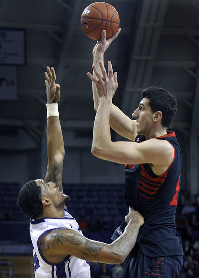 Texas Tech's Dejan Kravic, right, shoots against TCU's Adrick McKinney during an NCAA college basketball game Saturday, Jan. 5, 2013, in Fort Worth, Texas. Texas Tech defeated TCU 62-53. (AP Photo/The Fort Worth Star-Telegram, Joyce Marshall) MAGS OUT; (FORT WORTH WEEKLY, 360 WEST); INTERNET OUT